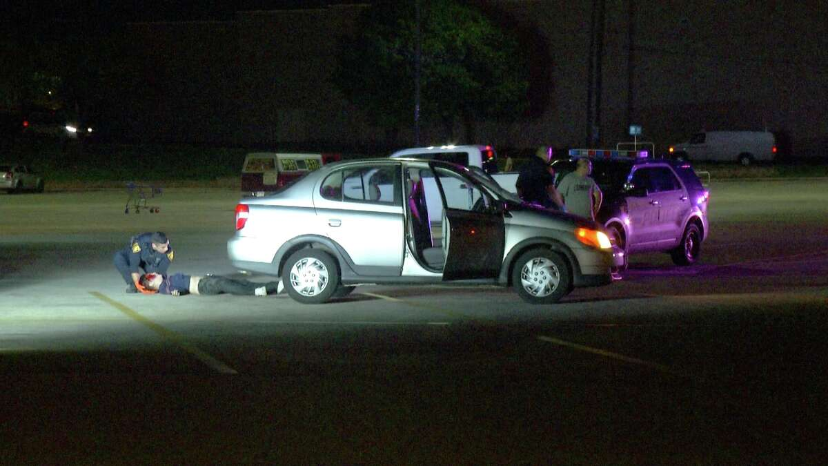 A woman was rushed to University Hospital after a car came to a stop on top of her Monday, Sept. 17, 2018, in a parking lot of a San Antonio Walmart.