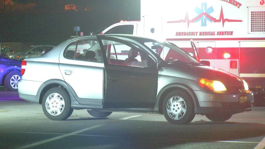A woman was rushed to University Hospital after a car came to a stop on top of her Monday, Sept. 17, 2018, in a parking lot of a San Antonio Walmart. Photo: Ken Branca