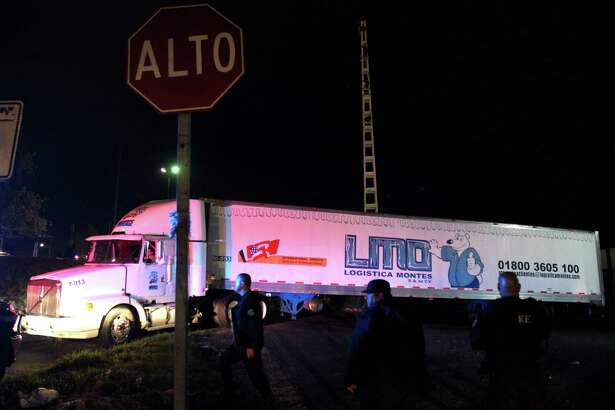 A trailer carrying more than 100 bodies of unidentified people is driven through the streets of Guadalajara after being taken from the winery of the prosecutor's in Guadalajara and transferred to the Jaliscience Institute of Forensic Sciences in Tlaquepaque, on Sptember 17, 2018. - Mexican authorities were scrambling to find a parking spot Monday for a truck carrying more than 100 unidentified bodies whose fetid smell has been infuriating residents in the city of Guadalajara. The refrigerated trailer -- rented when morgues in the country's second-largest city hit full capacity -- was parked for two weeks at a warehouse in the downtrodden neighborhood of Duraznera, on the city outskirts, until residents complained of the stench and the flies it attracted. . (Photo by Ulises Ruiz / AFP)ULISES RUIZ/AFP/Getty Images