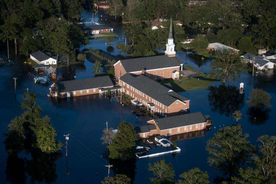 A church is surrounded by floodwaters from Hurricane Florence on September 17, 2018, in Conway, South Carolina. Many rivers in the Carolinas are approaching record flood stages and their levels will continue to rise through the week. Photo: Sean Rayford/Getty Images