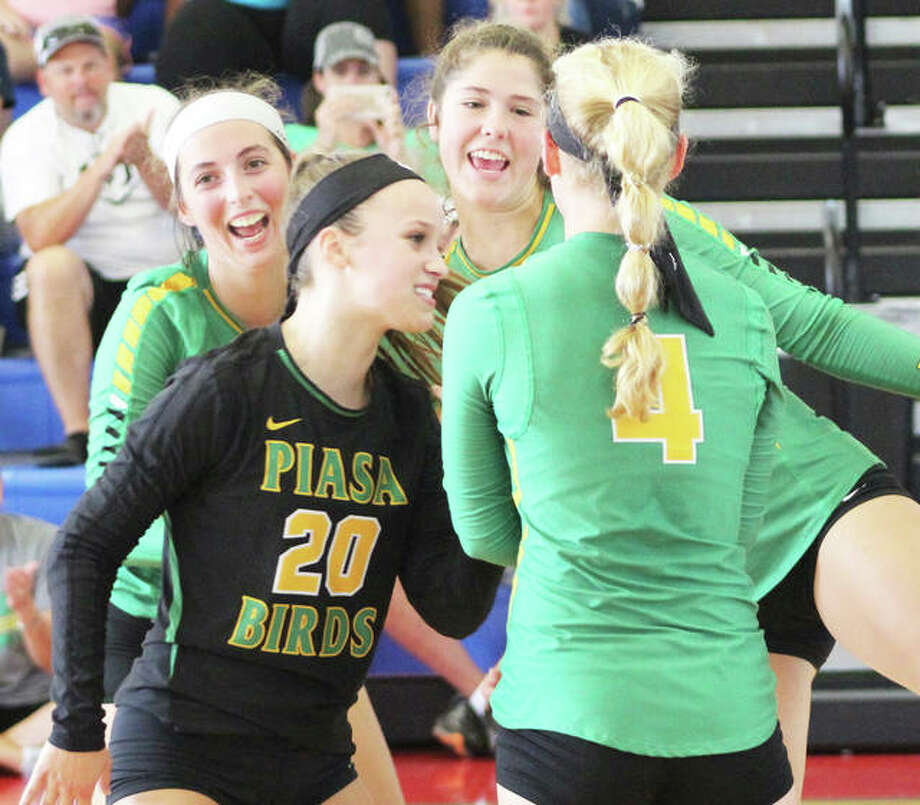 Southwestern's Karlee Paslay (left), Abbey Burns (20), Bailee Sorgea and Bri Roloff (4) celebrate a point during the Roxana Tournament on Aug. 25. The Piasa Birds were at Alton High on Monday and earned a three-set victory to push their record to 9-4-2. Photo: Greg Shashack / The Telegraph