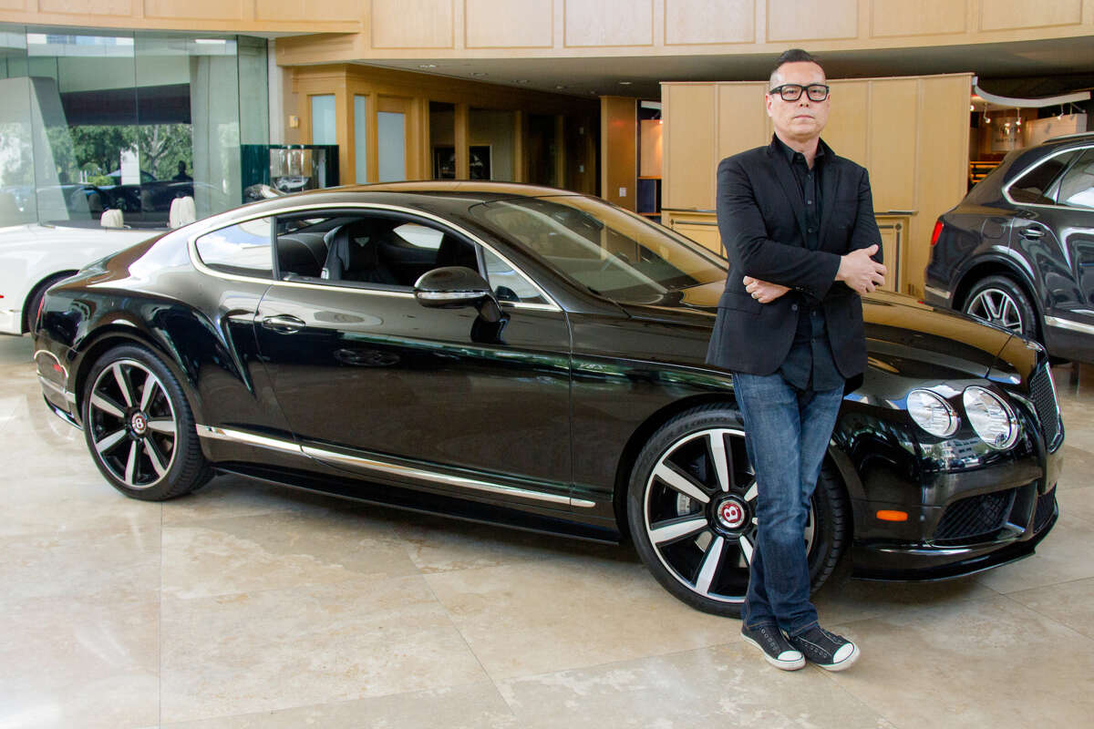 PHOTOS: Tilman Fertitta's empireRestaurateur Ken Bridge stands in front of his newly Bitcoin-purchased Bentley Continental GT in Tilman Fertitta's Post Oaks Motor Cars showroom.>>>See all of the other things Tilman Fertitta owns...