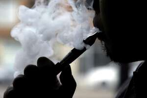 "Continuing to take aim at the ""epidemic"" of e-cigarette smoking among young people, the U.S. Food and Drug Administration has launched ""The Real Cost"" Youth E-Cigarette Prevention Campaign. (AP Photo/Nam Y. Huh, File)"
