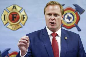 """Houston Professional Fire Fighters Association president Patrick """"Marty"""" Lancton speaks to the media after a judge sided with the association that Houston's City Hall improperly electioneered against firefighters' pay measure Tuesday July 31, 2018 in Houston."""