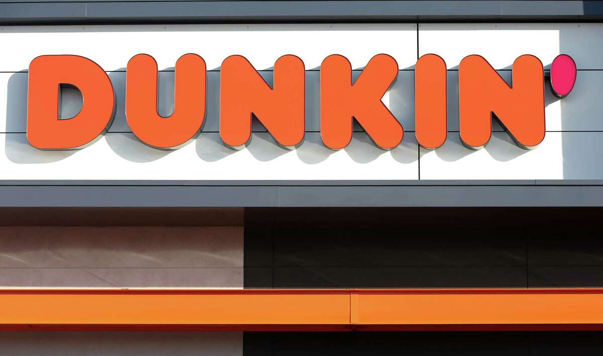 """A sign outside the new Dunkin' store in Quincy, MA is pictured on Jan. 16, 2018. The famed local chain debuted the new store with """"Donuts"""" removed from its name."""