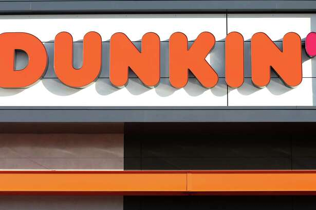 "QUINCY, MA - JANUARY 16: A sign outside the new Dunkin' store in Quincy, MA is pictured on Jan. 16, 2018. The famed local chain debuted the new store with ""Donuts"" removed from its name. (Photo by David L. Ryan/The Boston Globe via Getty Images)"