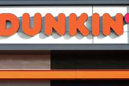 """QUINCY, MA - JANUARY 16: A sign outside the new Dunkin' store in Quincy, MA is pictured on Jan. 16, 2018. The famed local chain debuted the new store with """"Donuts"""" removed from its name. (Photo by David L. Ryan/The Boston Globe via Getty Images)"""