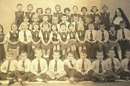 """Schools in the Greater New Milford area are back in session at public and private schools. One of the former New Milford schools was St. Francis Xavier School near the top of the Village Green. The school offered grades one through eight. Above, in this 1960 photograph, is the first-grade class at the St. Francis Xavier School. From left to right, in front, are Michael Cass, John Deak, Gregory Hume, John Fox, Harold Dunning, Michael Foster, Jeffery Narum, Scott Martina and Leon Yarrish; second row, Marita Martin, Donna Hallecks, Michael Kostes, Joy Bell, Donna Baske, Patty Dupill, Eileen Reese, Angela Onorato, Janet Knowles, Kevin Lynch, Steven Adams, Cathy O'Brien and Gerald Cowan; third row, Nanette Gonzalez, Carol Coughlin, Richard Begnoche, Michael Robinson, unknown, unknown, Mary Lee, Diana Tencza and Sister Marita Joseph; and in back, Katie Golembeski, Mary Jo Ploch, Karen Lebel, Patty Weber, Patty Farrell, Karen Barrett, Paula D'Alton, Laura Matoes, Gwenyth Durling and Christine Ognan. If you have a """"Way Back When"""" photograph you'd like to share, contact Deborah Rose at drose@newstimes or 860-355-7324"""