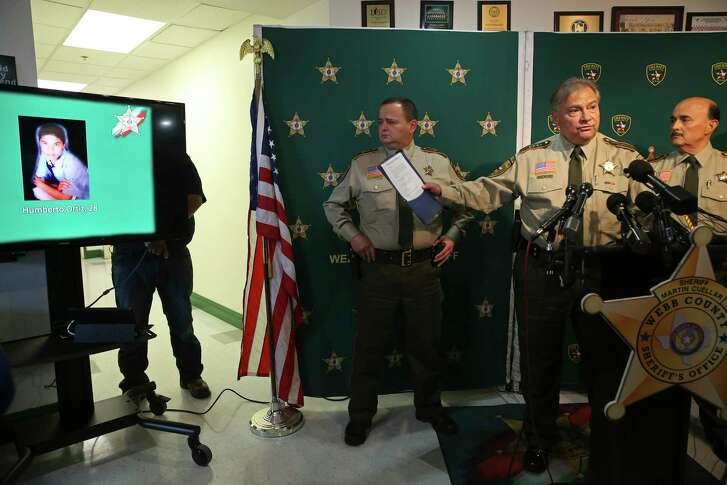 Webb County SheriffÕs Chief Deputy Federico Garza, second from right, presents a photograph of Humberto Ortiz, 29, during a press conference on the four serial murders, Monday, Sept. 17, 2018. U.S. Border Patrol agent Juan David Ortiz, 35, has been arrested in the murder of three women and Ortiz over a two-week period. The bodies were in an area near U.S. 83 in northwest Webb County. Ortiz was the last body found this past September 15. With Garza are Assistant Chiefs Juan Rendon, left, and Wayo Ruiz.
