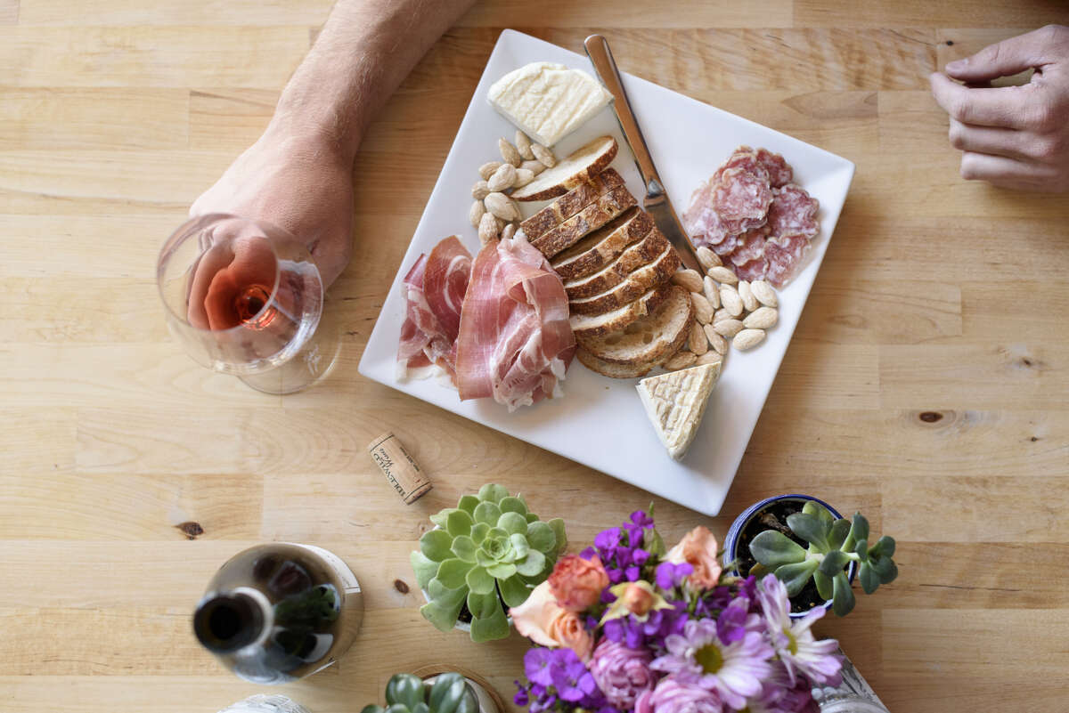 Owner Sam Bilbro holds a glass of the 2014 Nebbiolo next to a plate of the salumi and cheese at Idlewild Wines tasting room in Healdsburg, Calif., on Friday June 29, 2018.