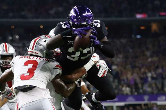 ARLINGTON, TX - SEPTEMBER 15: Sewo Olonilua #33 of the TCU Horned Frogs dives for a touchdown against the Ohio State Buckeyes during The AdvoCare Showdown at AT&T Stadium on September 15, 2018 in Arlington, Texas. (Photo by Ronald Martinez/Getty Images)