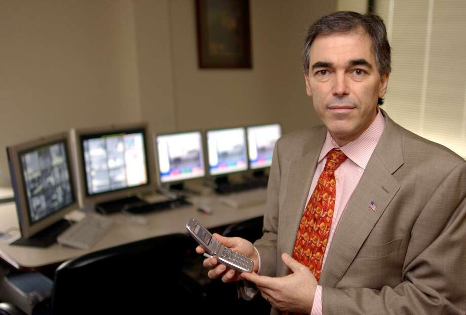 Jay Walker holds a cell phone at his offices in Stamford, Conn., on March 20, 2003. Walker is founder and executive chairman of Stamford-based Walker Innovations, a Stamford-based company focused on commercializing Walker's intellectual property. The firm has announced that it plans to dissolve on Sept. 20, 2018. Photo: DOUGLAS HEALEY / AP / AP