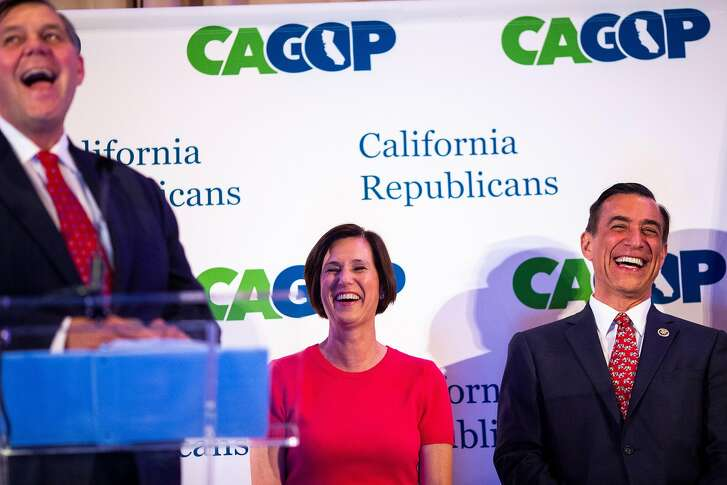 """Rep. Mimi Walters (center) and Sen. Darrell Issa laugh after Chairman Jim Brulte (left) mistakenly calls Sen. Issa """"Dana"""" during the California Congressional Dinner on Day 01 of the 2018 California Republican Party Convention and Candidate Fair at the Sheraton San Diego Hotel & Marina on Friday, May 4, 2018 in San Diego, Calif.  (Kent Nishimura / Los Angeles Times/TNS)"""