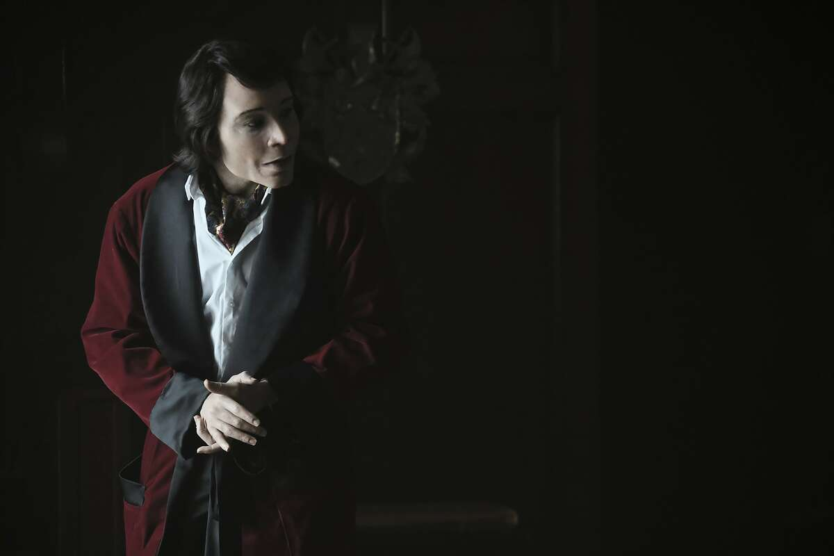 """This image released by FX shows Teddy Perkins in a scene from the comedy series """"Atlanta."""" Perkins appeared at the Emmys Monday night in the same attire as worn on the comedy-drama on the show, sporting red velvet dinner jacket, heavy white makeup, prosthetics and a bob cut wig. (Guy D'Alema/FX via AP)"""