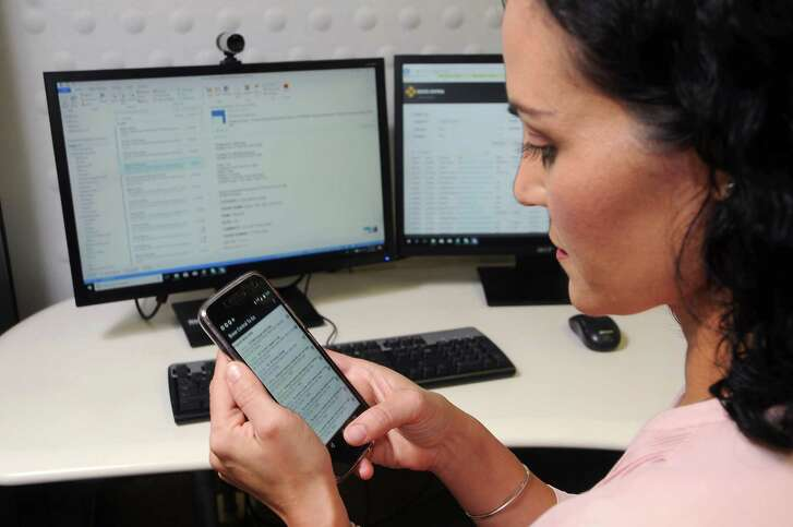 Boxer Property Manager Libby Leal uses the company's blockchain software at Boxer Property on N. Post Oak Thursday  Sept.13, 2018.(Dave Rossman photo)