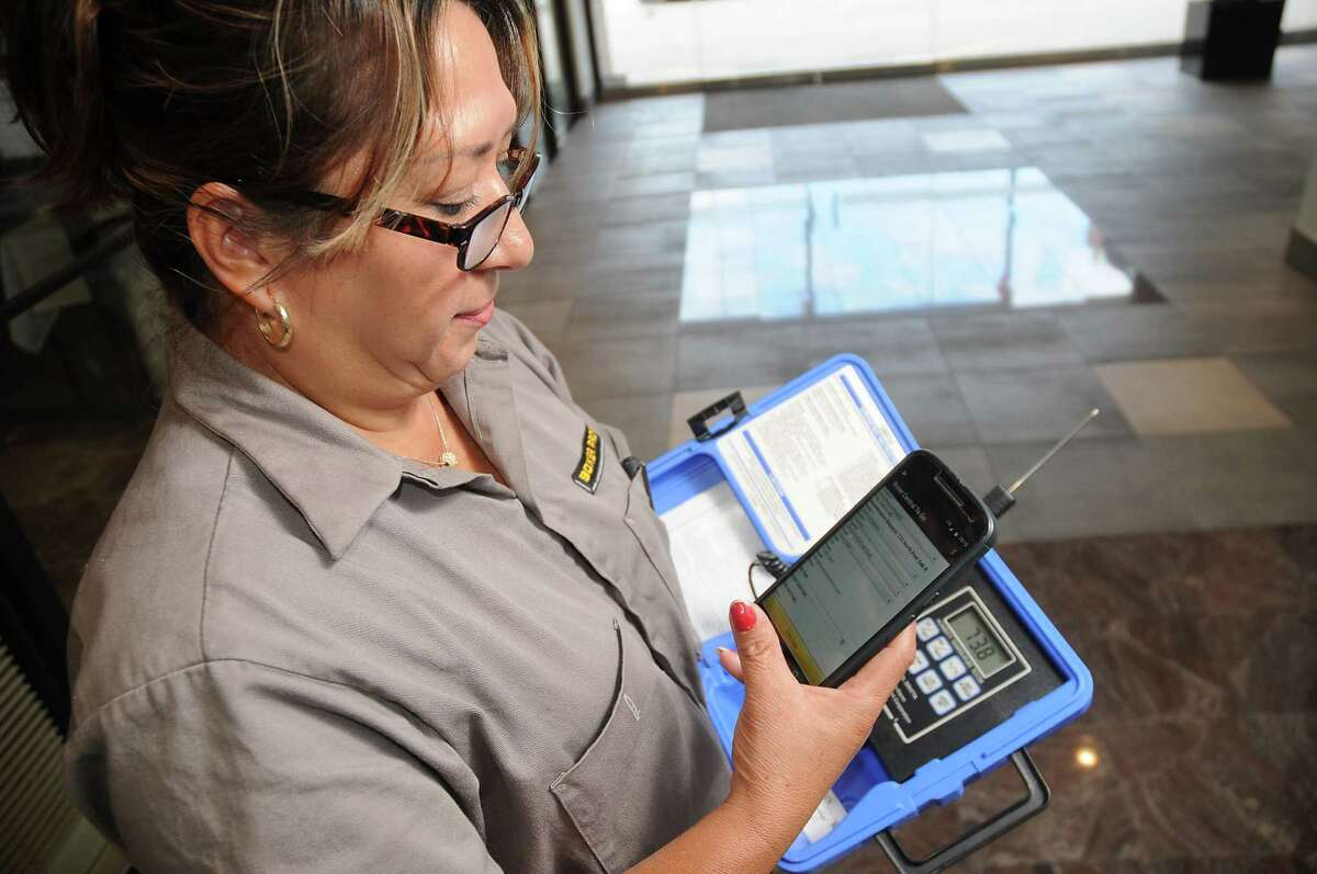 Maintenance worker Gloria Hernandez uses the mobile version of the blockchain software while taking temperature readings at Boxer Property on N. Post Oak Thursday Sept.13, 2018.(Dave Rossman photo)