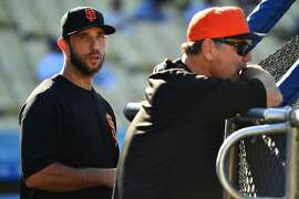 LOS ANGELES, CA - JUNE 15: San Francisco Giants pitcher Madison Bumgarner (40) looks on with manager Bruce Bochy before a MLB game between the San Francisco Giants and the Los Angeles Dodgers on June 15, 2018 at Dodger Stadium in Los Angeles, CA. (Photo by Brian Rothmuller/Icon Sportswire via Getty Images)
