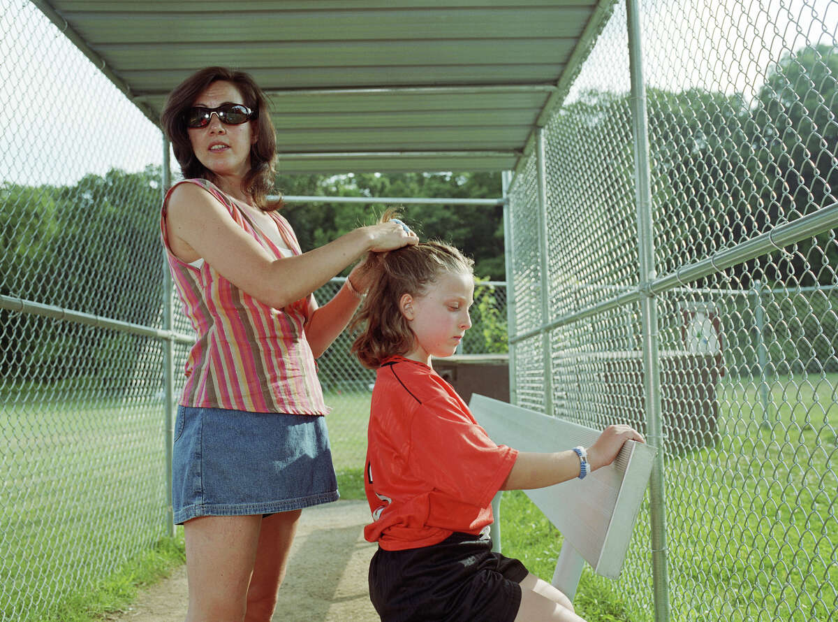 A soccer mom doesn't like that her husband and the coach of her kid's team once dated.