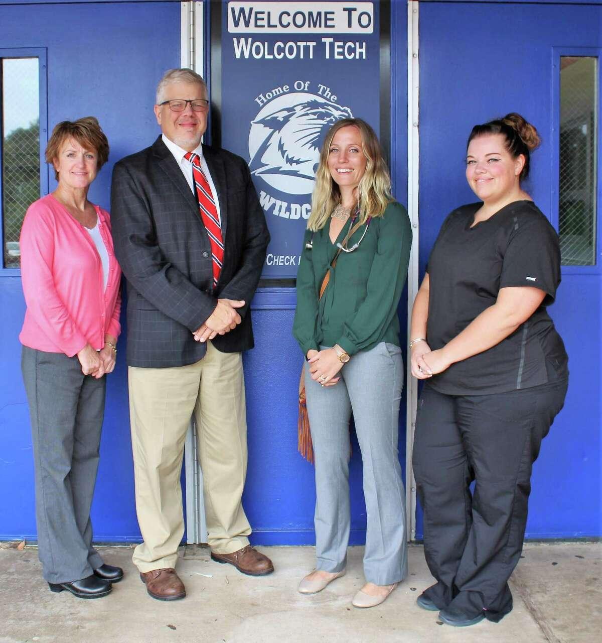 From left, Oliver Wolcott Technical High School nurse Debra Ismail, principal Richard Shellman, our provider, Jaimie Machado, RN, MSN, APRN and Grace Mottai, an LPN who assists Machado at the school.