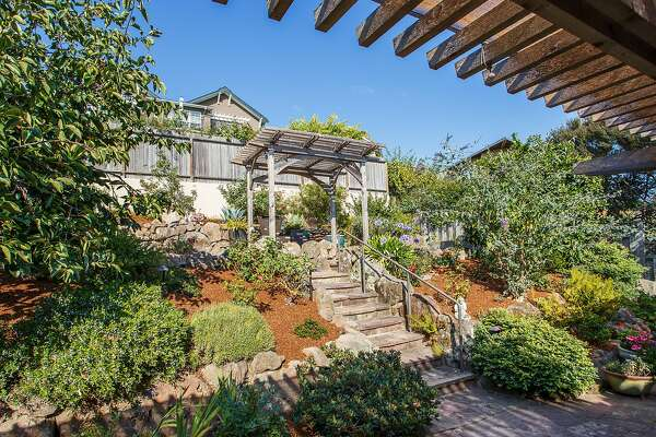Multiple patios wait behind the Upper Rockridge home.�