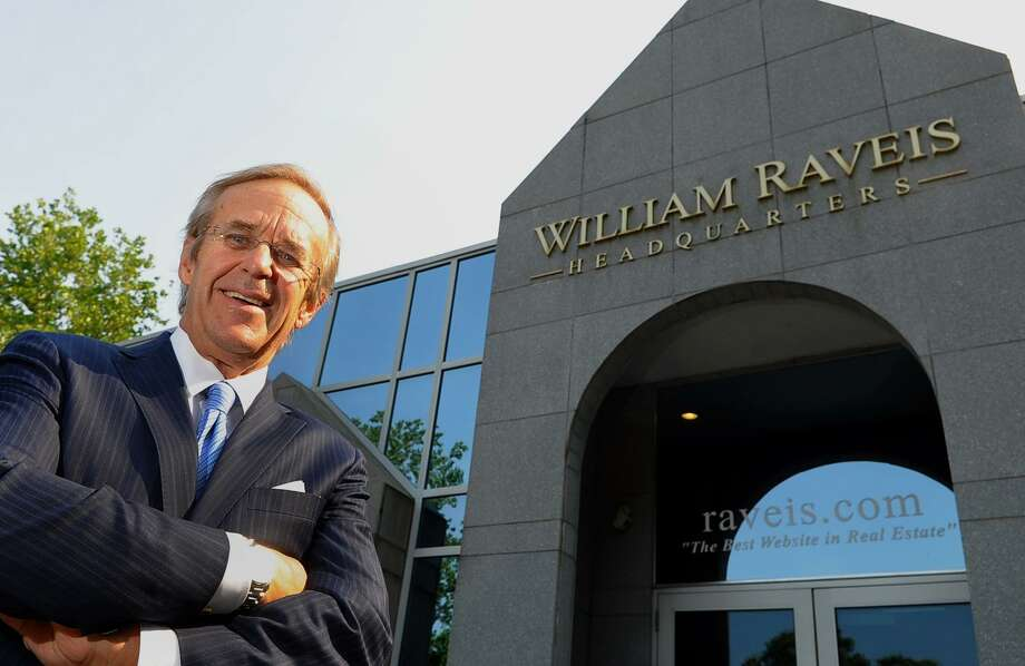William Raveis poses in front of the real estate company's headquarters in Shelton in 2013. Photo: Christian Abraham / Christian Abraham / Connecticut Post