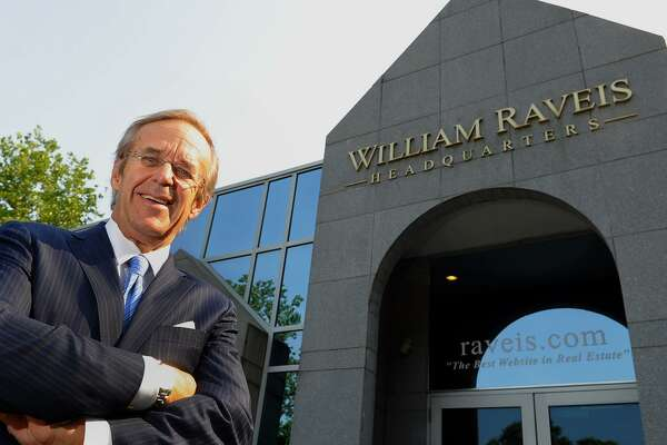 William Raveis poses in front of the real estate company's headquarters in Shelton in 2013.