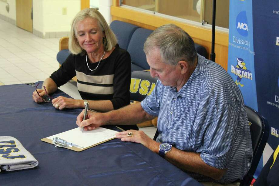 St. Joseph president Rhona Free and new basketball coach Jim Calhoun, who signed his coaching contract Tuesday. Photo: St. Joseph University