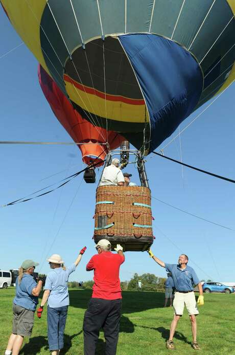 """The Greenwich Land Trust will hold """"Go Wild,"""" its annual Family Field Day, from 3 to 6 p.m. Sunday, Sept. 23. Take a ride on enormous hot air balloons soaring above the Greenwich Polo fields at Conyers Farm and enjoy activities and entertainment for all ages, including live music, a rock-climbing wall, petting zoo, bungee trampolines, inflatable maze, animal encounters, gaga courts, autumn crafts, and more. Admission covers all rides, food, and entertainment. Adult tickets are $65 in advance ($75 at the gate); child tickets are $30; children under 3 are free. For info and tickets, visit gltrust.org. Photo: File / Tyler Sizemore / Hearst Connecticut Media / Greenwich Time"""