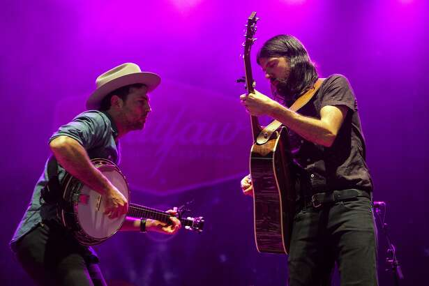 Singer/banjo player Scott Avett and singer/guitarist Seth Avett of The Avett Brothers peform at PNC Music Pavilion on June 20, 2018 in Charlotte, North Carolina.