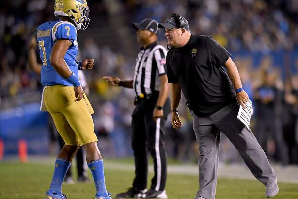 PASADENA, CA - SEPTEMBER 15: Head coach Chip Kelly of the UCLA Bruins talks with Dorian Thompson-Robinson #7 during the second quarter against the Fresno State Bulldogs at Rose Bowl on September 15, 2018 in Pasadena, California. (Photo by Harry How/Getty Images)