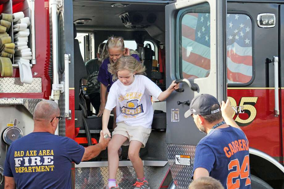 Bad Axe Elementary students took part in an emergency vehicle expo Tuesday afternoon. Pictured are third grade students touring the inside of a Bad Axe Fire Department truck. Photo: Seth Stapleton/Huron Daily Tribune