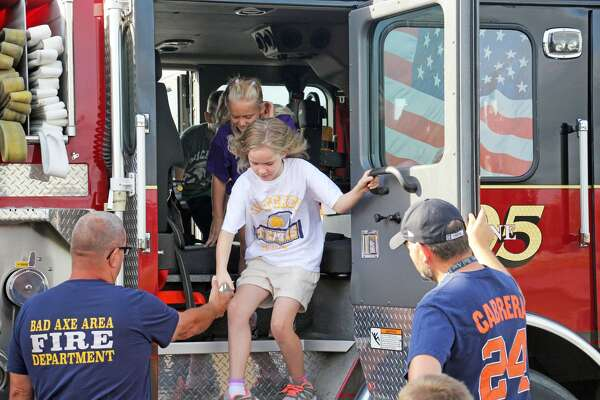 Bad Axe Elementary students took part in an emergency vehicle expo Tuesday afternoon. Pictured are third grade students touring the inside of a Bad Axe Fire Department truck.
