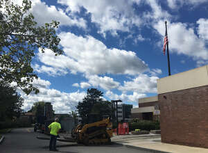 Construction begins on the front entrance of the Colonie town library on Albany Shaker Road on Tuesday, Sept. 18, 2018.