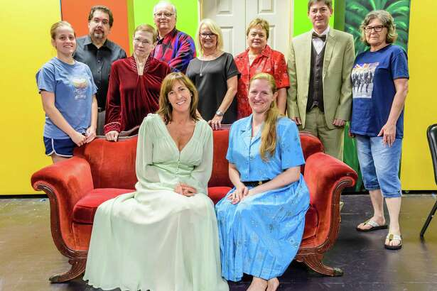 """Purple Box Theater artistic director Kathy Holbrook, center, shown with the cast and crew """"The Haunted of Hill House,"""" is planning productions ranging from a princess show for children to the cult favorite """"The Rocky Horror Show."""""""