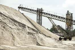 Sand is a key ingredient in concrete and asphalt, the basic building materials of metropolitan regions.