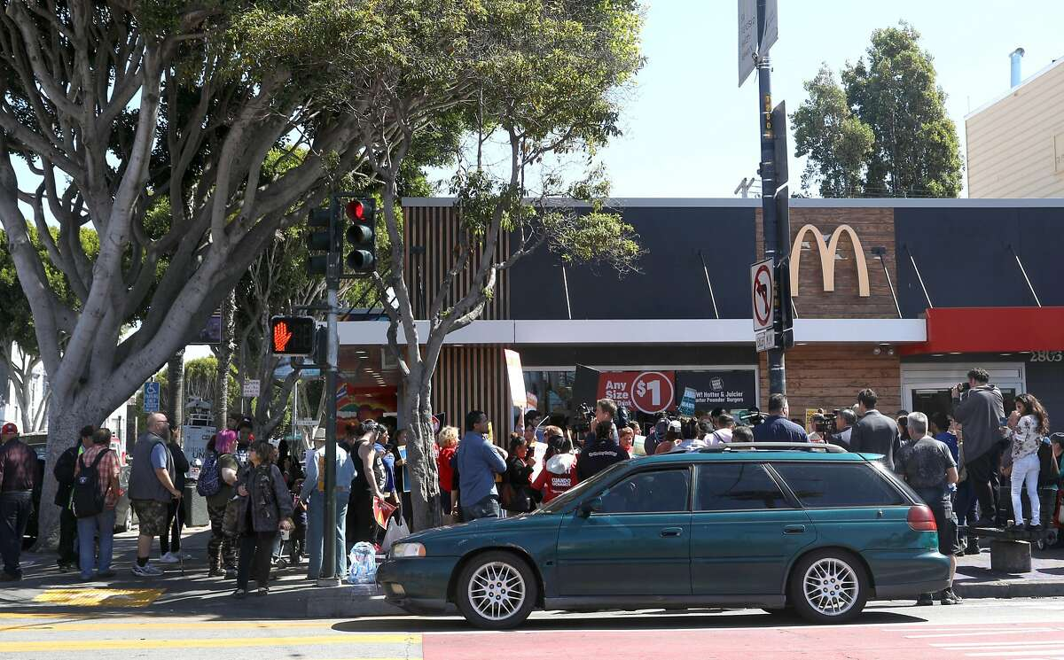 Protesters at the McDonald's on Mission at 24th streets protest the inadequate protections against sexual harassment in the workplace on Tuesday, Sept. 18, 2018, in San Francisco, Calif. McDonald's workers in 10 cities across the country plan to strike at lunchtime today.