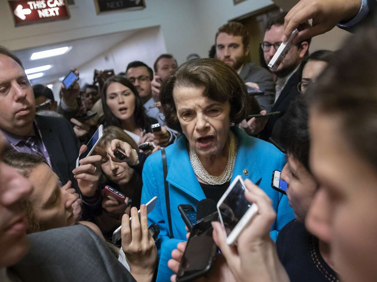 Sen. Dianne Feinstein, D-Calif., the ranking member on the Senate Judiciary Committee, responds to reporters' questions on Supreme Court nominee Brett Kavanaugh amid scrutiny of a woman's claim he sexually assaulted her at a party when they were in high school, on Capitol Hill in Washington, Tuesday, Sept. 18, 2018. (AP Photo/J. Scott Applewhite)