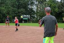 New Canaan Softball players practice their pitches at Orchard Field in Waveny Park.