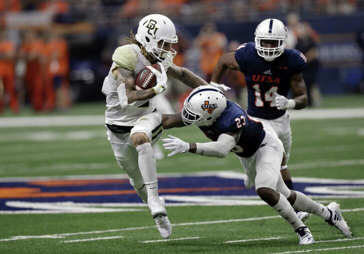 UTSA wide receiver Jalen Hurd (5) tries to avoid a hit by UTSA safety Darryl Godfrey (23) following a catch during the second half of an NCAA college football game, Saturday, Sept. 8, 2018, in San Antonio. (AP Photo/Eric Gay)