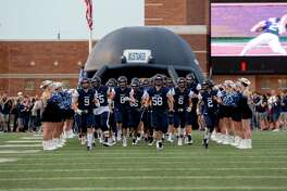 Kingwood football team exit the inflatable helmet prior to the game between Kingwood vs. Atascocita during a high school football game at the George Turner Stadium, Friday, September 14, 2018, in Humble. (Juan DeLeon/Contributor)