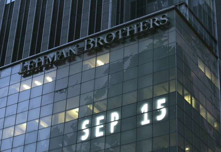 Lehman Brothers world headquarters is shown in New York in Sept. 15, 2008, the day the 158-year-old investment bank, choked by the credit crisis and falling real estate values, filed for bankruptcy. The ensuing bailout of other firms resulted in populist fury still felt today.