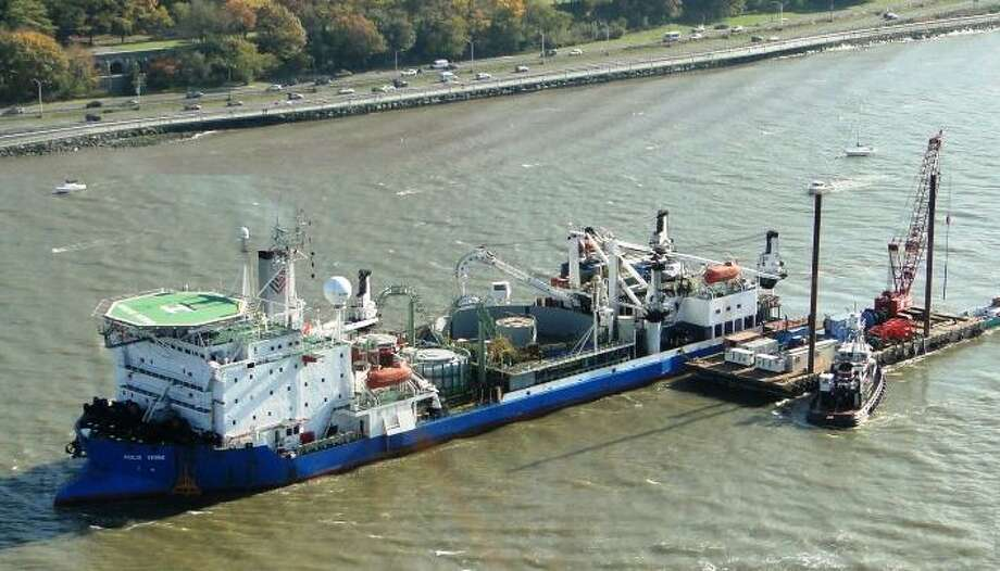 The cable laying ship, the Giulio Verne, at work in November 2011 in the Hudson River with Manhattan's West Side Highway in the background. (File photo via Hudson Transmission Partners)