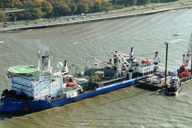 The cable laying ship, the Giulio Verne, at work in November 2011 in the Hudson River with Manhattan?'s West Side Highway in the background. (File photo via Hudson Transmission Partners)