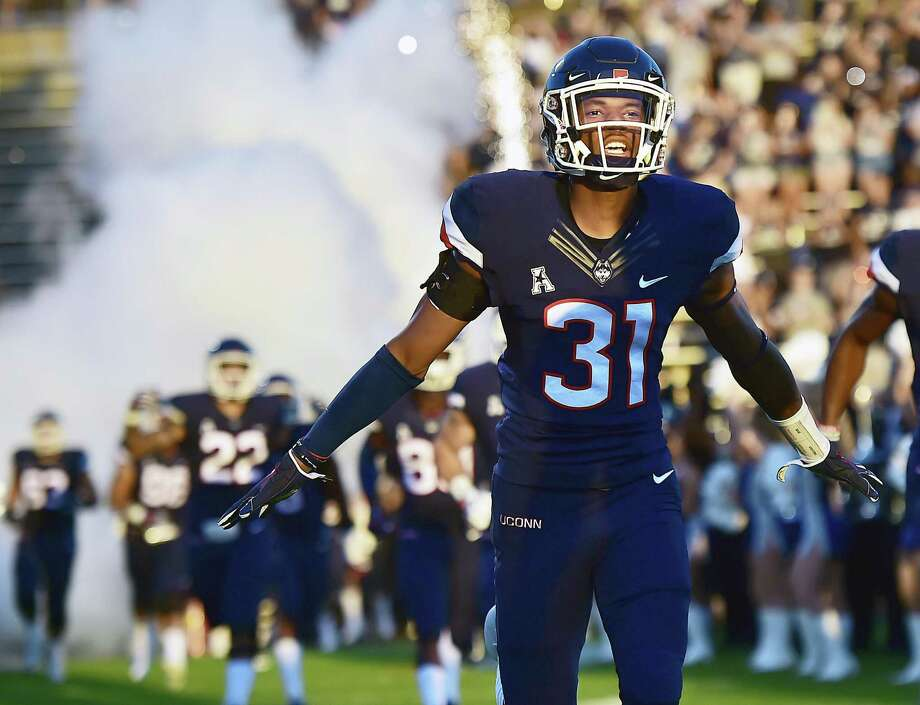 Former Capital Prep star and current UConn freshman defensive back Oneil Robinson runs onto Rentschler Field before the Huskies' Aug. 30 season opener against UCF. Photo: Catherine Avalone / Hearst Connecticut Media / New Haven Register