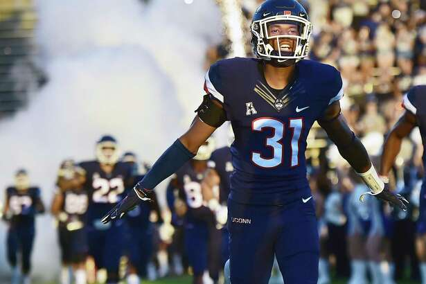 Former Capital Prep star and current UConn freshman defensive back Oneil Robinson runs onto Rentschler Field before the Huskies' Aug. 30 season opener against UCF.