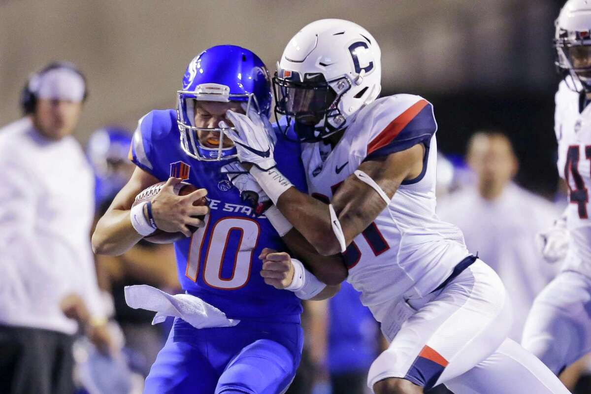 UConn defensive back Oneil Robinson hits Boise State quarterback Chase Cord on Sept. 8.