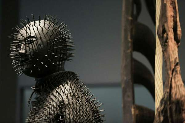 "A much-loved spiked costume is displayed at the center of the refreshed ""Witnesses to a Surrealist Vision"" room."