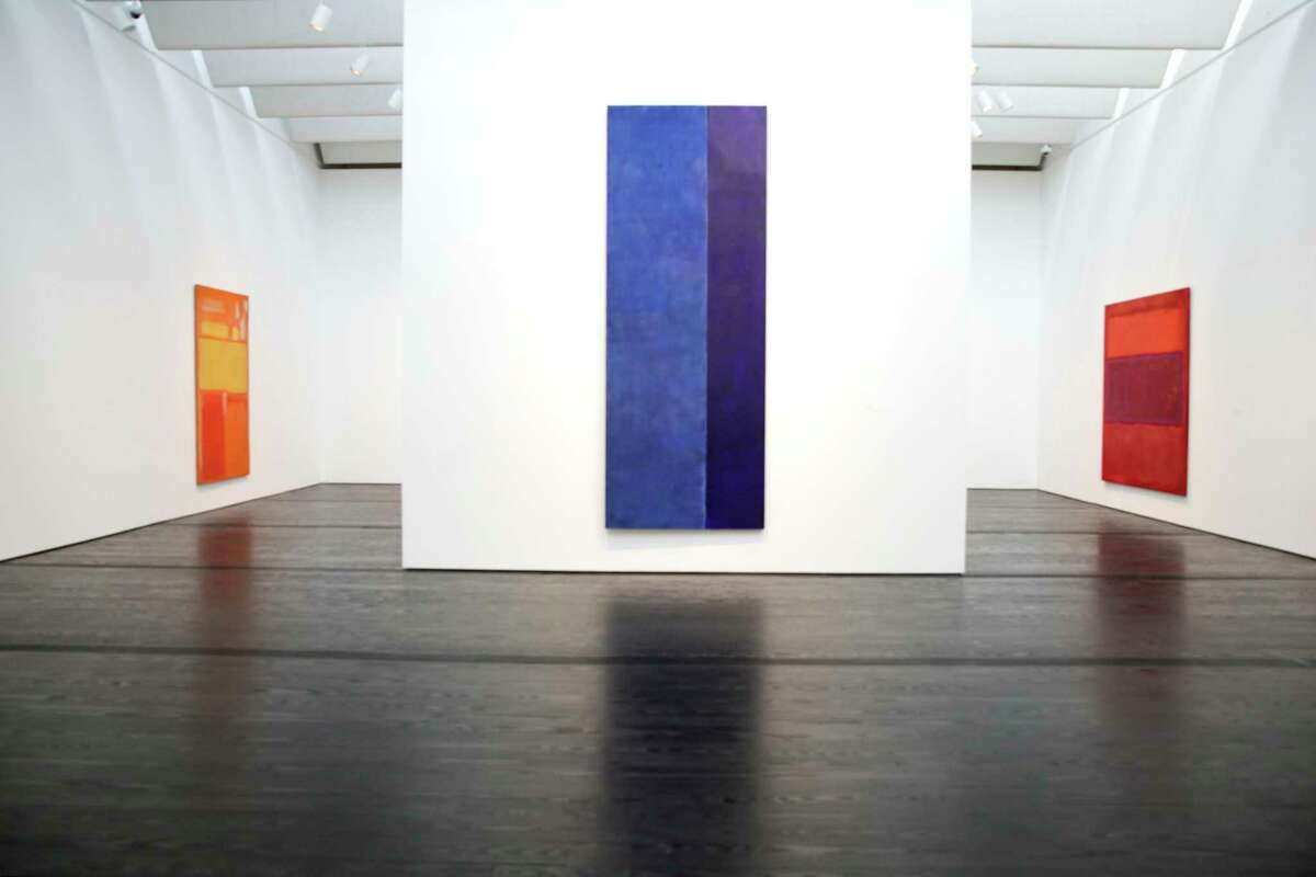 Barnett Newman's Ulysses, center flanked by Rothko paintings in the updated Menil Collection, on Tuesday, Sept. 18, 2018 in Houston. The free museum will re-open this Saturday being closed since February for renovation.
