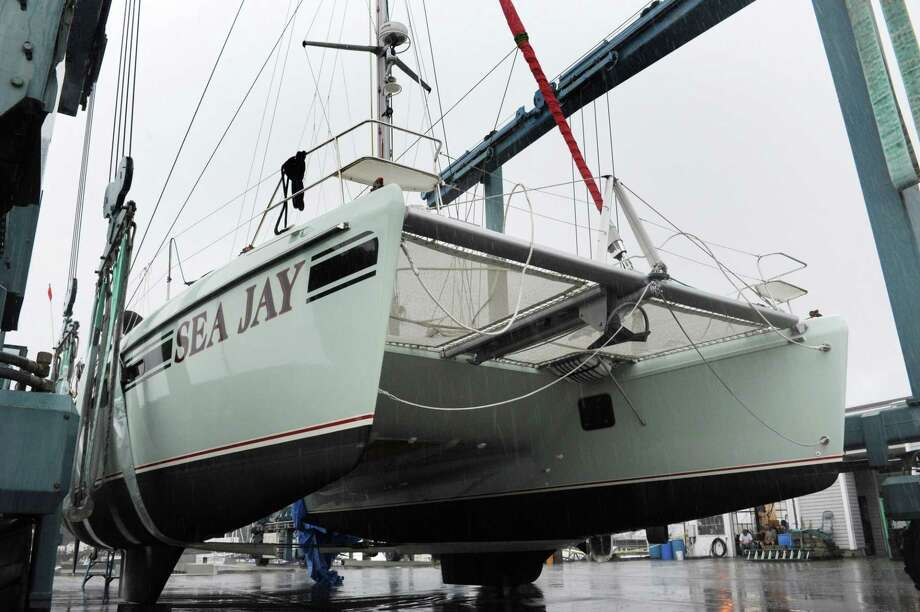 The multimillion dollar catamaran, Sea Jay, at Cove Marina Tuesday, September 18, 2018, in Norwalk, Conn. The yacht got smashed Monday in the West Branch of Stamford Harbor when two barges being towed by a tug boat got loose and hit the dock at the Hinckley boatyard. Photo: Erik Trautmann / Hearst Connecticut Media / Norwalk Hour