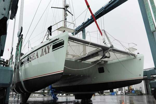 The multimillion dollar catamaran, Sea Jay, at Cove Marina Tuesday, September 18, 2018, in Norwalk, Conn. The yacht got smashed Monday in the West Branch of Stamford Harbor when two barges being towed by a tug boat got loose and hit the dock at the Hinckley boatyard.
